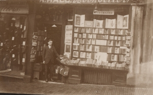 Postcard of Harry Pratley outside Hall's Bookshop circa 1920s.